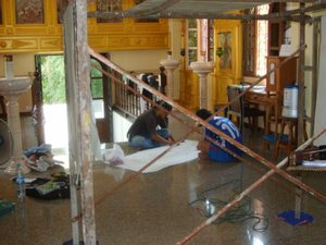 Work on the painting at All Saints temple in Pattaya