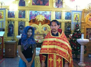 The newly baptised Miss Maria (Pityapak) Paosiri after her baptism in the Church of All Saints in Pattaya with priest Daniel Wanna