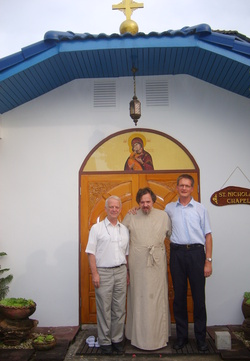 Russian Orthodox Church in Thailand Representative hegumen Oleg (Cherepanin) (center), Jukko Helle, Thailand's Finnish Lutheran mission head (right), Brother Ghislain - member of ecumenic community from Teze (France) (left) near the Chapel of Saint Nicholas Wonder-Worker, Arch-Bishop of Mira in Lycia.