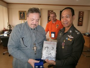Archimandrite Oleg presents general Thartsart with Katya and the Prince of Siam book