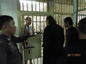 The Representative of the Russian Orthodox Church in Thailand archimandrite Oleg (Cherepanin) and the Chairman of the Orthodox Christian Church in Thailand Foundation Committee fr. Daniel Wanna visit Anatoly Karajani in police custody