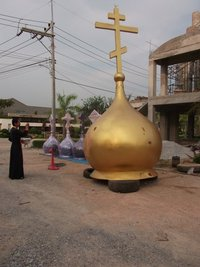 Priest Daniel Wanna blesses the dome of the new Church in the South Pattaya
