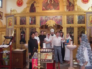 His Grace bishop Nikolai of Nakhodka and Preobrazhensk in the Church of All Saints after administering the Sacrament of matrimony and giving  Patriarch Kirill's award to Mr. Panferov